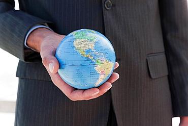 Businessman holding globe, Businessman holding globe