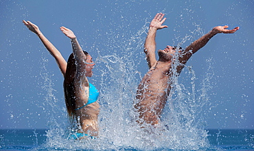 Couple playing together in water, Couple playing together in water