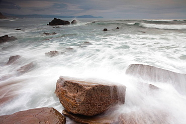 Waves washing over rocks on beach. Waves washing over rocks on beach