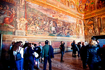 Visitors admiring frescoes in the Hall of Constantine in the Vatican Museum, Rome, Italy