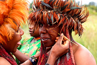 Portrait of two local Papuan girls, getting traditional face painting, Baliem Valley festival, Jayawijaya region, Papua, Indonesia, Southeast Asian