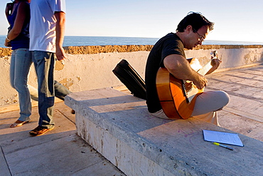 playing the guitar in levee of Campo del Sur Cadiz, Andalusia, Spain