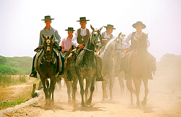 During Pentecost some pilgrims cover on horseback a three days journey through Donana National Park to El Rocio, Huelva province, Andalusia, Spain