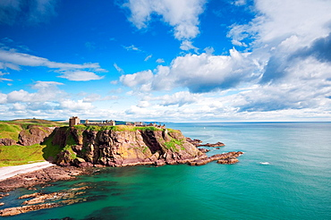 Dunnottar Castle, Stonehaven, Aberdeenshire, Scotland A medieval fortress located on a rocky outcrop 3 km south of Stonehaven The site has held a fortress since the Dark Ages but most of the surviving buildings are from the 15-16th century the Castle p. Dunnottar Castle, Stonehaven, Aberdeenshire, Scotland A medieval fortress located on a rocky outcrop 3 km south of Stonehaven The site has held a fortress since the Dark Ages but most of the surviving buildings are from the 15-16th century the Castle played an important role in the history of Scotland from the Middle Ages to the Enlightenment WIlliam Wallace is said to have led the Scots to victory over thr English at Dunnottar in 1296 including incarceration of the defeated English soldiers in the castle church Mary Queen of Scots visited the castle twice in 1562 and 1564 James IV was in residence for part of 1580 The Scottish Royal Regalia crown, sword and sceptre were hidden here during the 17th century the garrison was held under seige by the English for 8 months but the Regalia were secreted away to Kinneff Parish Church These can now be seen in Edinbugh Castle In more recent times the castle has been used as a set in Mel Gibson's film version of 'Hamlet'