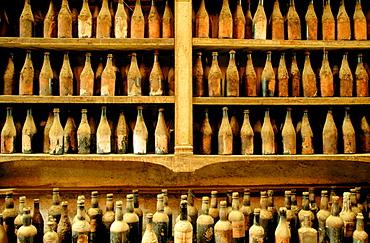 Bodega Gonzalez Byas, show room with old sherry, brandy and wine bottles, Jerez de la Frontera, Cadiz province, Andalusia, Spain