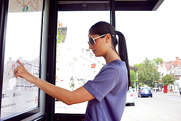 Woman reading urban bus map. Woman reading urban bus map
