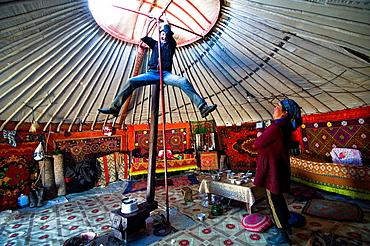 Happy moments inside a Kazakh yurt.
