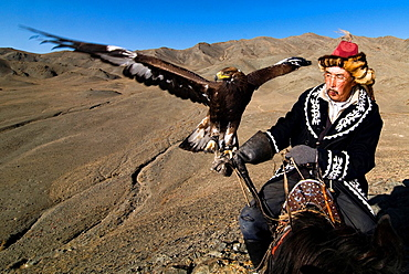 Pride! An Eagle hunter with his Golden Eagle.