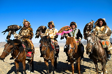 A group of eagle hunters from the Altai region arrive to the eagle hunting festival at Olgii in western Mongolia.