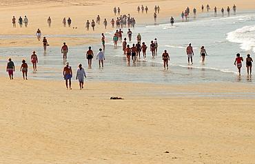 People walking at the beach named Praia America Panxon, Galicia, Spain