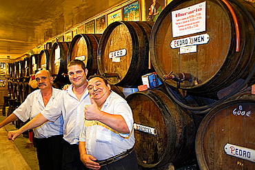 Antigua Casa de Guardia, Bodega, tavern, waiters in front of wine barrels, Malaga, Andalucia, Spain