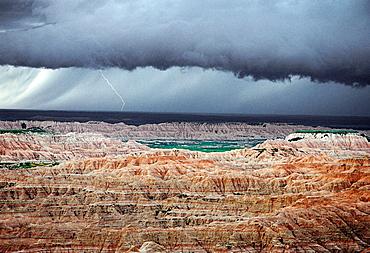 Lightning storm above sedimentary formations, North Unit, Badlands National Park, South Dakota, USA
