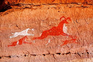 Painted hunting scene, rock art in the Akakus Mountains, Sahara Desert, Libya