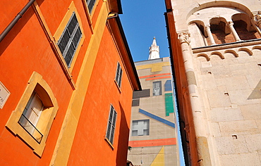 Italy, Modena, part of the Cathedral (right) and its bell-tower, the Ghirlandina, covered during a restoring process
