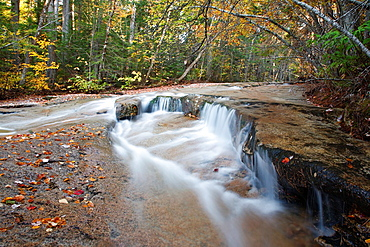 Ledge Brook during the autumn months in the White Mountains, New Hampshire USA This brook is located off of the Kancamagus Scenic Byway, which is one of New England's scenic byways