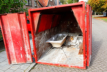 Bath and rubble in red container, Amersfoort, Netherlands