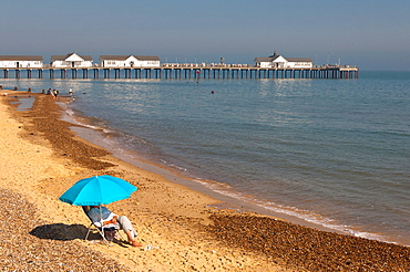People on the seafront and beach in the summer in Southwold, Suffolk, England, Britain, Uk