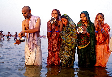 Pilgrims bathing at Sangam (the intersection of Yamuna River and Ganges River) during Kumbh Mela festival, Allahabad, Uttar Pradesh, India