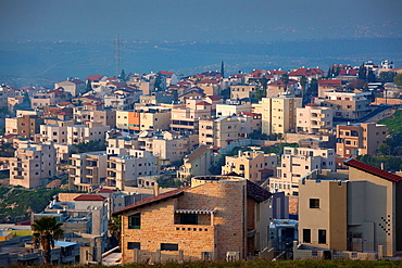 Israel, The Galilee, Nazareth, elevated city view, dusk