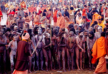 Procession of naked pilgrims going for a holy bath in Ganges River during Khumb Mela Festival (2001), Allahabad, Uttar Pradesh, India