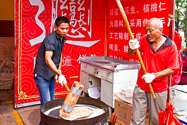 Preparing outdoor street food in Xian, China, Asia
