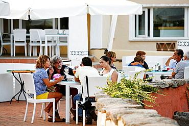 People sitting at a restaurant in Porto Cervo, Costa Smeralda, Sardinia, Italy