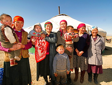 Kazakh eagle hunter's family in front of their ger yurt in the Altai Region of Bayan-Olgii in Western Mongolia