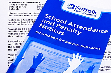 A warning letter sent from Suffolk County Council to parents taking their children out of school for a holiday threatening to fine them £50