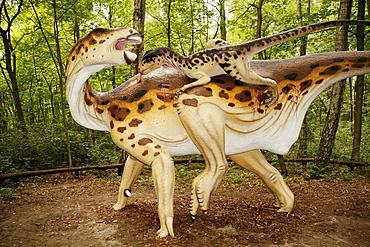Deinonychus attacks Iguanodon in Leba Park dinosaur theme park, Poland