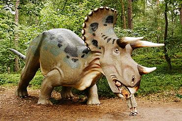 Boy in a dinosaur's mouth