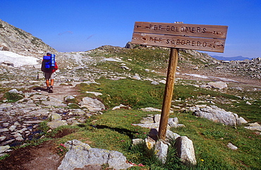 hiker in 'Port de Ratera' Ratera pass, Aiguestortes i Estany de Sant Maurici National Park, Pyrenees, Lleida province, Catalonia, Spain