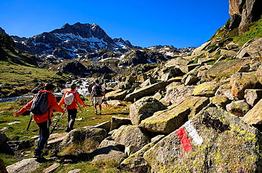 Trippers and Signposting of GR-11 in Circ de Colomers, near Obago lake, Aran Valley, Aiguestortes and Estany de Sant Maurici National Park, Pyrenees, Lleida province, Catalonia, Spain