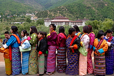 Pilgrims on queue to enter the religious tsechu festival, Thimphu, Bhutan