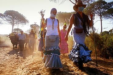 Pilgrims in El Cerro del Trigo,Romeria del Rocio, pilgrims on their way through the Donana National Park, pilgrimage of Sanl√∫car de Barrameda brotherhood, to El Rocio, Almonte, Huelva province, Andalucia