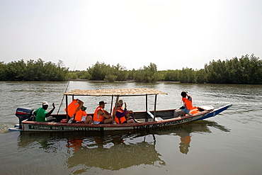 Bird watchers take boat trip on Allahein River in south of The Gambia