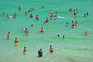 Holidaymakers swim bathe and cool off in shallow water Boujaffar Beach Sousse Tunisia