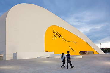 Spain, Asturias Region, Asturias Province, Aviles, Centro Niemeyer, arts center designed by Brazilian architect Oscar Niemeyer in formerly polluted industrial city, built 2011, late afternoon