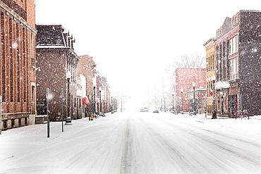 Snow falling on city street