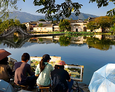 Group of student painters at South Lake in Hongcun World Heritage Site Anhui Province China