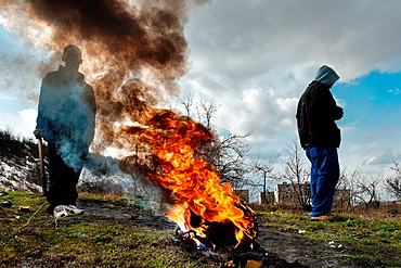 Young boys burn the used electric wires to recycle copper and sell it afterwards in the Gipsy ghetto of Chanov on outskirts of Most, Czech Republic, 22 March 2008