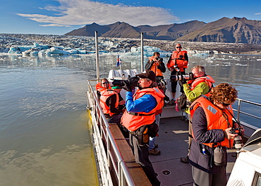 Photographers on boat tour of the Jokulsarlon Glacial Lagoon, Iceland