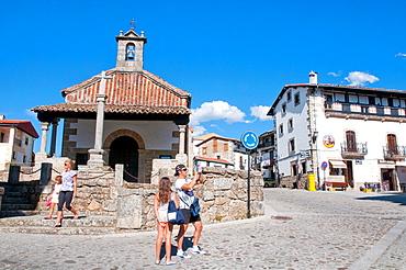 Family at Main Square. Candelario, Salamanca province, Castilla Leon, Spain.