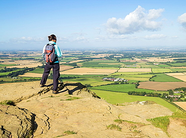 Female hiker on Roseberry Topping 320m on The Cleveland Way National Trail  North York Moors National Park near Great Ayton, North Yorkshire, England, United Kingdom