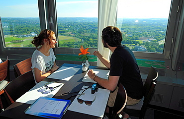 D-Dortmund, Ruhr area, Westphalia, North Rhine-Westphalia, NRW, Westfalenpark, Westphalian Park, Florianturm, Florian tower, television tower, tourists sit in the revolving restaurant, young couple, landscape, panoramic view