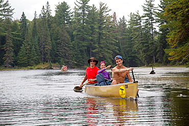 Algonquin Provincial Park, Ontario Canada - Young people canoeing on Fawn Lake