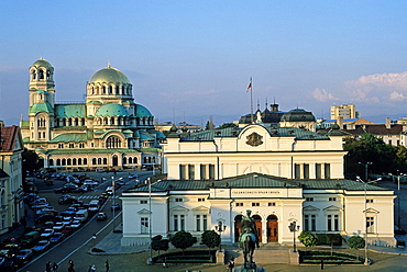 the National Assembly with with Alexander Nevsky Cathedral background, Sofia, Bulgaria, Europe