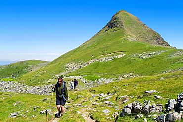 Hikers walking in Roncal valley and Arlas peak  Larra-Belagua massif  Pirineos  Navarra  Spain