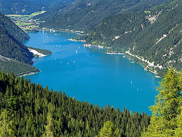Lake Achensee in Tyrol, Austria  This mountain lake seperates the Karwendel mountain ranges from the Brandenberger Alps with the Rofan mountains next to the lake  Europe, Central Europe, Austria, Tyrol, August