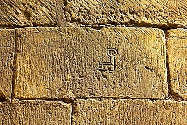 Mason marks on the stones of the church of Santiago, Romanesque Style, Aguero, Huesca, Aragon, Spain, Europe