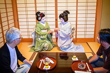 Fukuyu,geisha and Fukukimi,¥maiko¥ geisha apprentice workimg in Miyaki tea house o-chaia Geisha¥s distric of Miyagawacho Kyoto  Kansai, Japan